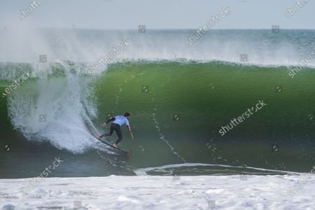 The Brazilian Surfer, Pedro Scooby rides on a wave