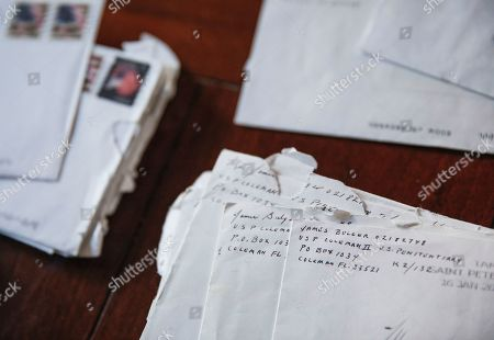 "Letters addressed to Janet Uhlar that she received through her correspondence with imprisoned Boston organized crime boss James ""Whitey"" Bulger, sit on her dining room table, in Eastham, Mass. Uhlar started writing Bulger, she said, because she was troubled by the fact that much of the evidence against him came through testimony by former criminal associates who were also killers and had received reduced sentences in exchange for testifying against their former partner in crime. ""When I left the trial, I had more questions,"" she said"