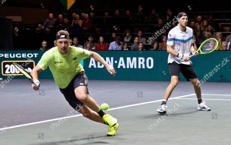Henri Kontinen (L) of Finnland and Jan-Lennard Struff of Germany compete during the doubles final match