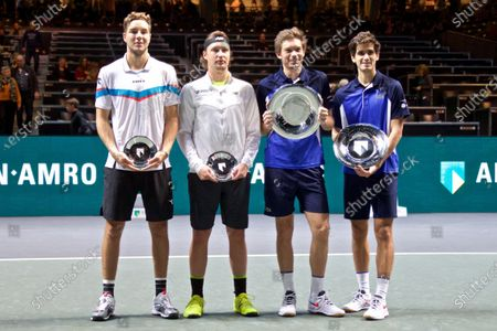 First placed Pierre-Hugues Herbert and Nicolas Mahut of France along with second placed Henri Kontinen of Finland and Jan-Lennard Struff of Germany (from R to L) pose for photos during the awarding ceremony after their doubles final match