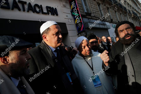 French author Marek Halter, right, with Imam Hassen Chalghoumi, second left, and a group of Imams from Europe gather in front of the Bataclan concert hall during a tribute for victims of the November 2015 Paris attacks in which130 people were killed, in Paris, . Chalghoumi launches the first European Conference of Imams Against Radicalization until Thursday Feb 20