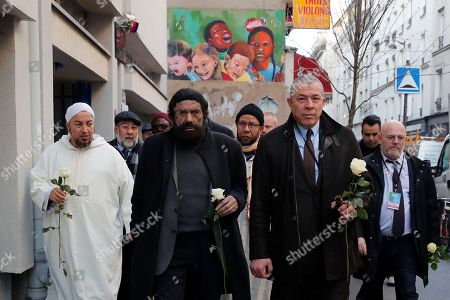 French author Marek Halter and a group of Imams from Europe walk to the front of the Bataclan concert hall during a tribute for victims of the November 2015 Paris attacks in which130 people were killed, in Paris, . Chalghoumi launches the first European Conference of Imams Against Radicalization until Thursday Feb 20