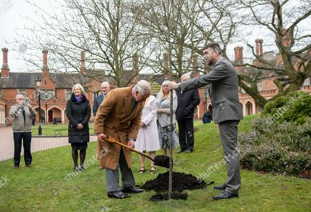 Prince Charles planting a tree during a visit to the Nicholas Chamberlaine Almshouses in Bedworth, during a tour of Warwickshire and the West Midlands