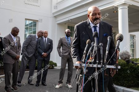 Former NFL football player Jim Brown speaks after walking out of the West Wing of White House, in Washington. It was announced that President Donald Trump has granted a full pardon to Edward DeBartolo Jr., former owner of the San Francisco 49ers NFL football team convicted in gambling fraud scandal