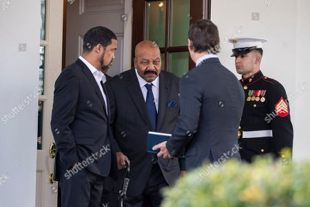 Hogan Gidley, Jim Brown, Darrell Scott. Deputy White House press secretary Hogan Gidley, second from right, stands as former NFL football player Jim Brown, second from left, walks out of the West Wing of White House accompanied by pastor Darrell Scott, left, in Washington. It was announced that President Donald Trump has granted a full pardon to Edward DeBartolo Jr., former owner of the San Francisco 49ers NFL football team convicted in gambling fraud scandal