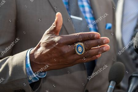 The NFL Pro Football Hall of Fame ring is seen on the finger former NFL football players Jerry Rice as he speaks after walking out of the West Wing of White House accompanied by, in Washington. It was announced that President Donald Trump has granted a full pardon to Edward DeBartolo Jr., former owner of the San Francisco 49ers NFL football team convicted in gambling fraud scandal