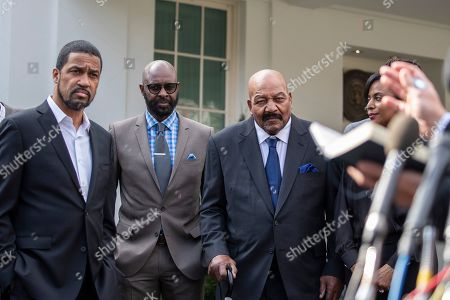 Jerry Rice, Jim Brown, Darrell Scott. Pastor Darrell Scott, left, former NFL football players Jerry Rice, and Jim Brown, listen after walking out of the West Wing of White House, in Washington. It was announced that President Donald Trump has granted a full pardon to Edward DeBartolo Jr., former owner of the San Francisco 49ers NFL football team convicted in gambling fraud scandal