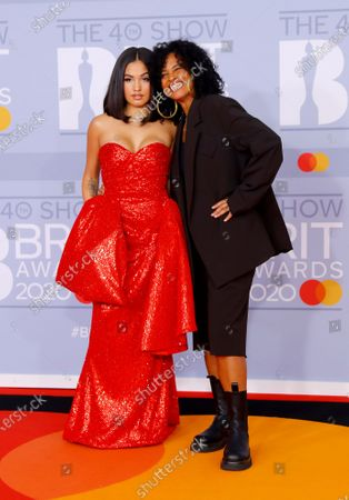 British singer Mabel (L) arrives with Swedish songwriter Neneh Cherry (R) for the Brit Awards 2020 at the O2 Arena in London, Britain 18 February 2020. It is the 40th edition of the British Phonographic Industry's annual pop music awards.