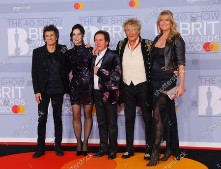 Ronnie Wood (L), his wife Sally Wood (2- L), British drummer for Small Faces and the Who Kenney Jones (C), British singer Rod Stewart (2-R) and his wife Penny Lancaster (R) arrive for the Brit Awards 2020 at the O2 Arena in London, Britain 18 February 2020. It is the 40th edition of the British Phonographic Industry's annual pop music awards.