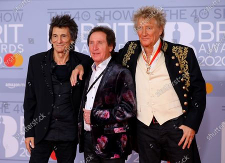 Ronnie Wood (L), British singer Rod Stewart (C) and British drummer for Small Faces, Faces, and the Who Kenney Jones (R) arrive for the Brit Awards 2020 at the O2 Arena in London, Britain 18 February 2020. It is the 40th edition of the British Phonographic Industry's annual pop music awards.