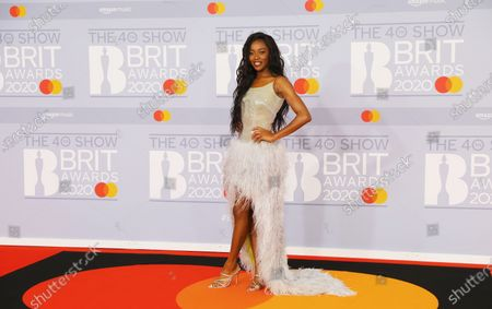 British television presenter Aj Odudu arrives for the Brit Awards 2020 at the O2 Arena in London, Britain 18 February 2020. It is the 40th edition of the British Phonographic Industry's annual pop music awards.
