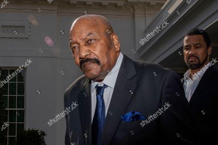 Jim Brown, Darrell Scott. Former NFL football player Jim Brown and pastor Darrell Scott, right, attend a news conference outside the West Wing of the White House, in Washington. It was announced that President Donald Trump has granted a full pardon to Edward DeBartolo Jr., former owner of the San Francisco 49ers NFL football team convicted in a gambling fraud scandal