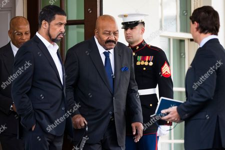 Jim Brown, Darrell Scott, Hogan Gidley. Former NFL football player Jim Brown, center, together with pastor Darrell Scott, left, and Deputy White House press secretary Hogan Gidley, right, walk from the West Wing of the White House, in Washington. It was announced that President Donald Trump has granted a full pardon to Edward DeBartolo Jr., former owner of the San Francisco 49ers NFL football team convicted in a gambling fraud scandal
