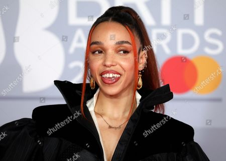 FKA Twigs poses for photographers upon arrival at Brit Awards 2020 in London