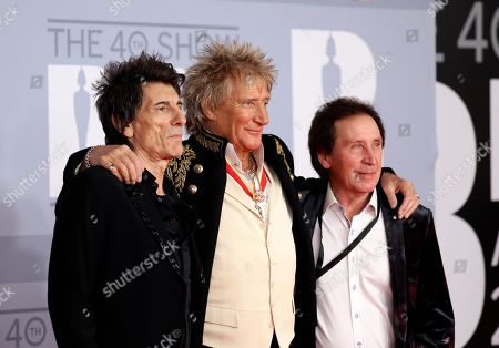 From left, Ronnie Wood, Rod Stewart and Kenney Jones pose for photographers upon arrival at Brit Awards 2020 in London