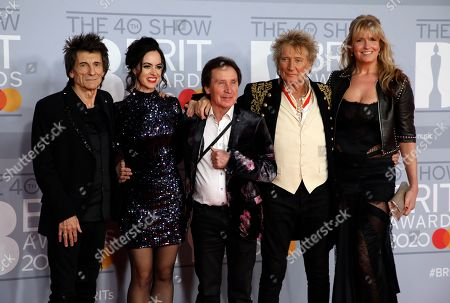 From left, Ronnie Wood, Sally Wood, Kenney Jones, Rod Stewart and Penny Lancaster pose for photographers upon arrival at Brit Awards 2020 in London