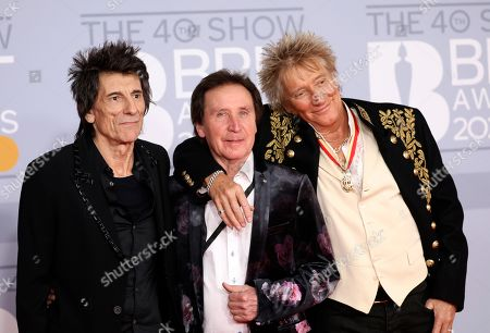 From left, Ronnie Wood, Kenney Jones and Rod Stewart pose for photographers upon arrival at Brit Awards 2020 in London
