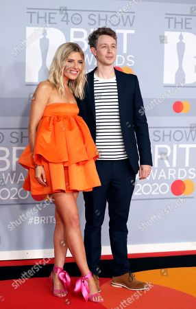 Mollie King and Matt Edmondson pose for photographers upon arrival at Brit Awards 2020 in London
