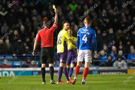 Referee Craig Hicks gives a yellow card to Gary Warren of Exeter City during Portsmouth vs Exeter City, Leasing.com Trophy Football at Fratton Park on 18th February 2020