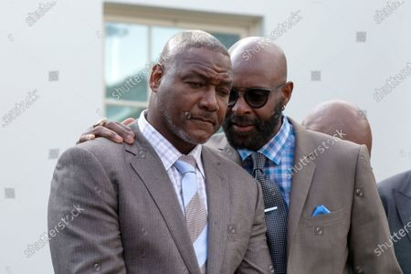 Former professional football player Jerry Rice speaks to Former professional football Derrick Brooks outside the White House in Washington after United States President Donald Trump granted a full pardon to Edward DeBartolo Jr., former owner of the San Francisco 49ers, who was convicted after pleading guilty in a gambling fraud scandal in 1998.