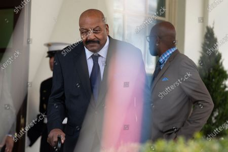 Stock Photo of Former professional football player Jim Brown walks to speak to members of the media outside the White House in Washington after United States President Donald Trump granted a full pardon to Edward DeBartolo Jr., former owner of the San Francisco 49ers, who was convicted after pleading guilty in a gambling fraud scandal in 1998.