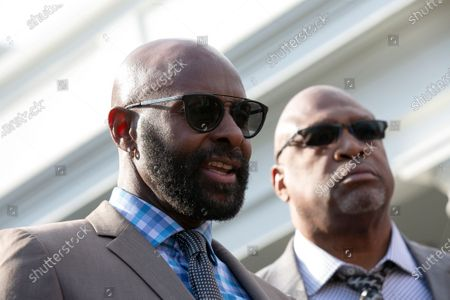 Former professional football player Jerry Rice speaks to members of the media outside the White House in Washington after United States President Donald Trump granted a full pardon to Edward DeBartolo Jr., former owner of the San Francisco 49ers, who was convicted after pleading guilty in a gambling fraud scandal in 1998.