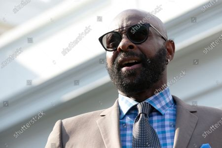Stock Picture of Former professional football player Jerry Rice speaks to members of the media outside the White House after United States President Donald J. Trump granted a full pardon to Edward DeBartolo Jr., former owner of the San Francisco 49ers, who was convicted after pleading guilty in a gambling fraud scandal in 1998.