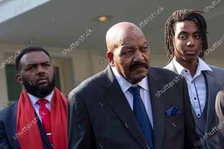 Former professional football player Jim Brown speaks to members of the media outside the White House after United States President Donald J. Trump granted a full pardon to Edward DeBartolo Jr., former owner of the San Francisco 49ers, who was convicted after pleading guilty in a gambling fraud scandal in 1998.