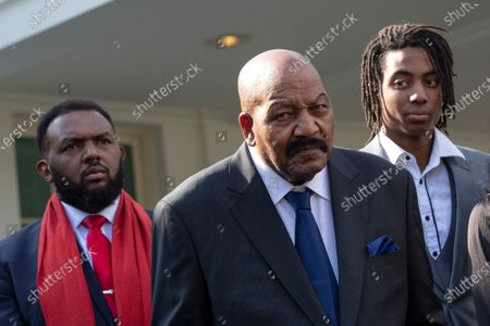 Stock Picture of Former professional football player Jim Brown speaks to members of the media outside the White House after United States President Donald J. Trump granted a full pardon to Edward DeBartolo Jr., former owner of the San Francisco 49ers, who was convicted after pleading guilty in a gambling fraud scandal in 1998.