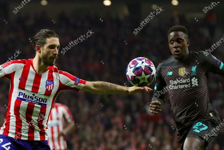Atletico's defender Sime Vrsaljko (L) vies for the ball against Liverpool's striker Divock Origi (R) during the UEFA Champions League round of 16 first leg match between Atletico de Madrid and Liverpool FC at Wanda Metropolitano in Madrid, Spain, 18 February 2020.