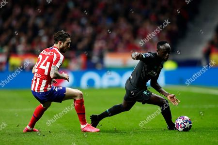 Liverpool's Sadio Mane, right, controls the ball as Atletico Madrid's Sime Vrsaljko defends during a 1st leg, round of 16, of the Champions League soccer match between Atletico Madrid and Liverpool at the Wanda Metropolitano stadium in Madrid