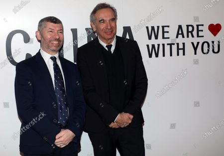 Italian Undersecretary for Foreign Affairs Ivan Scalfarotto (L) and Carlo Capasa, President of National Chamber of Italian Fashion, a non-profit organization, whose purpose is the promotion, coordination of the Italian fashion industry and the training of young Italian designers, attend the Han Wen Special Fashion Show and Institutional Launch of the initiative 'China, we are with you' in Milan, Italy, 18 February 2020.