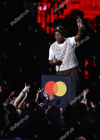 Tyler, the Creator accepts his award for International Male Solo Artist on stage at the Brit Awards 2020 in London