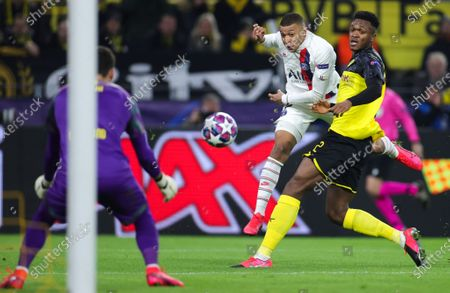 Stock Image of PSG's Kylian Mbappe (C) in action against Dortmund's goalkeeper Roman Burki (L) and Dan-Axel Zagadou (R) during the UEFA Champions League round of 16 first leg soccer match between Borussia Dortmund and Paris Saint-Germain in Dortmund, Germany, 18 February 2020.