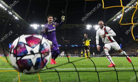 Stock Photo of PSG's Neymar Jr (R) reacts after scoring a goal against Dortmund's goalkeeper Roman Burki (L) during the UEFA Champions League round of 16 first leg soccer match between Borussia Dortmund and Paris Saint-Germain in Dortmund, Germany, 18 February 2020.