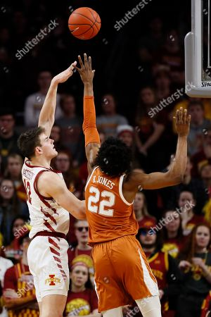 Iowa State forward Michael Jacobson, left, shoots over Texas forward Kai Jones, right, during the second half of an NCAA college basketball game, in Ames, Iowa