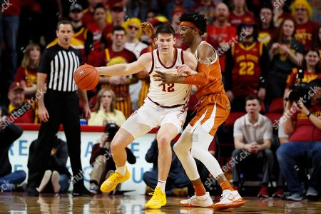 Iowa State forward Michael Jacobson drives around Texas forward Kai Jones, right, during the second half of an NCAA college basketball game, in Ames, Iowa
