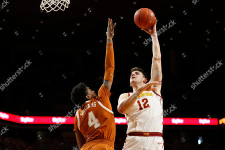 Iowa State forward Michael Jacobson shoots over Texas guard Donovan Williams (4) during the first half of an NCAA college basketball game, in Ames, Iowa