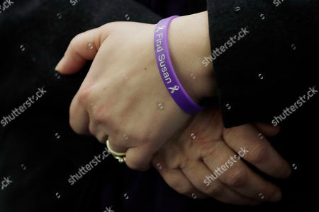 """Denise Ernest, the sister of missing Utah woman Susan Cox Powell, wears a bracelet that reads """"Find Susan,"""", during a break in a session of Pierce County Superior Court in Tacoma, Wash., on the first day of a civil lawsuit over the murder of the Susan's two young sons Charlie and Braden, who were attacked and killed by their father Josh Powell in 2012 while he was under suspicion for Susan Powell's disappearance. The parents of Susan Cox Powell allege that negligence by the Washington state Department of Social and Health Services was a contributing factor that led to the deaths of their grandsons"""