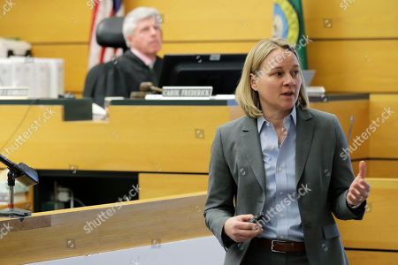 Stock Picture of Assistant Washington state Attorney General Lori Nicolavo, right, makes her opening arguments, in Pierce County Superior Court in Tacoma, Wash., on the first day of a civil lawsuit over the murder of Charlie and Braden Powell, who were attacked and killed by their father Josh Powell in 2012 while he was under suspicion for the disappearance of his wife, Susan Powell in Utah. The boys' grandparents allege that negligence by the Washington state Department of Social and Health Services was a contributing factor that led to the deaths of their grandsons
