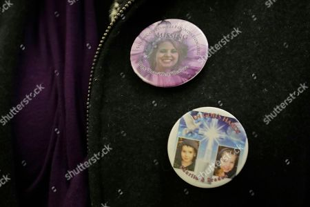 Denise Ernest, the sister of missing Utah woman Susan Cox Powell, wears buttons with the photos of her sister, Susan Cox Powell, and her nephews Charlie and Braden, during a break in a session of Pierce County Superior Court in Tacoma, Wash., on the first day of a civil lawsuit over the murder of the Charlie and Braden, who were attacked and killed by their father Josh Powell in 2012 while he was under suspicion for Susan Powell's disappearance. The parents of Susan Cox Powell allege that negligence by the Washington state Department of Social and Health Services was a contributing factor that led to the deaths of their grandsons