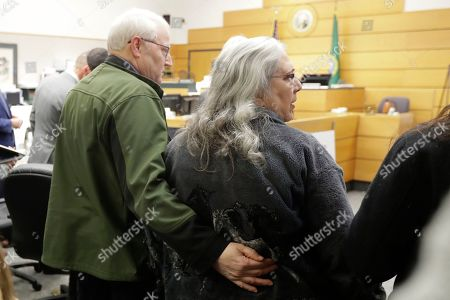 Chuck Cox, left, and his wife, Judy Cox, right, stand, during a break in a session of Pierce County Superior Court in Tacoma, Wash., on the first day of a civil lawsuit over the murder of the Cox's young grandsons. Chuck and Judy are the parents of missing Utah woman Susan Cox Powell and the grandparents of Susan's sons Charlie and Braden, who were attacked and killed by their father Josh Powell in 2012 while he was under suspicion for Susan Powell's disappearance. The Coxes allege that negligence by the Washington state Department of Social and Health Services was a contributing factor that led to the deaths of their grandsons