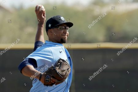 Stock Picture of Seattle Mariners pitcher Aaron Fletcher throws during baseball spring training, in Peoria, Ariz