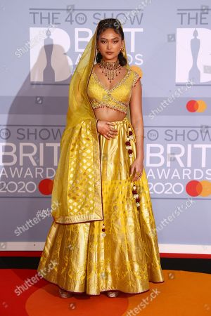 Joy Crookes poses for photographers upon arrival at the Brit Awards 2020 in London