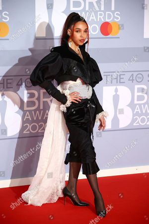FKA twigs poses for photographers upon arrival at the Brit Awards 2020 in London
