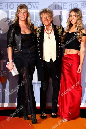 Rod Stewart, Penny Lancaster, Ruby Stewart. Penny Lancaster, Rod Stewart and Ruby Stewart pose for photographers upon arrival at the Brit Awards 2020 in London