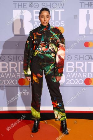 Grace Carter poses for photographers upon arrival at the Brit Awards 2020 in London