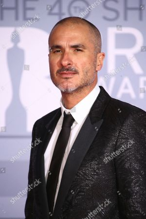 Zane Lowe poses for photographers upon arrival at the Brit Awards 2020 in London