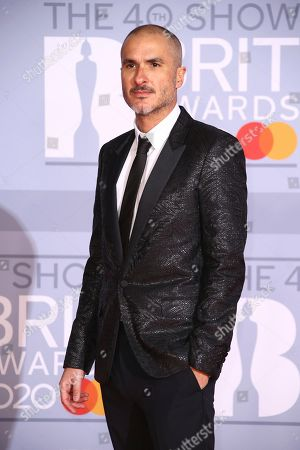 Stock Image of Zane Lowe poses for photographers upon arrival at the Brit Awards 2020 in London