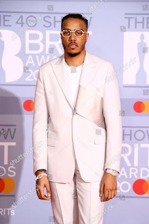 AJ Tracey poses for photographers upon arrival at the Brit Awards 2020 in London